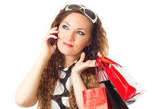 Woman with shopping bags isolated over a white Stock Photo