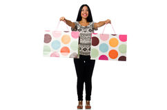 The woman with shopping bags isolated on white Stock Photography