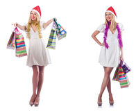 The woman with shopping bags isolated on white Stock Image