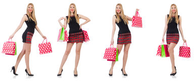 The woman with shopping bags isolated on white Stock Photos