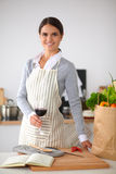 Woman with shopping bags in the kitchen at home, Stock Image