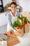 Woman with shopping bags in the kitchen at home, Stock Photos