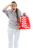 Woman with shopping bags looking into distance Stock Photo