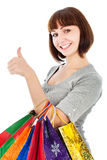 Woman with shopping bags make her thumbs up Royalty Free Stock Photography