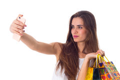 Woman with shopping bags making selfie Royalty Free Stock Images