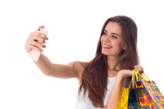 Woman with shopping bags making selfie Stock Images