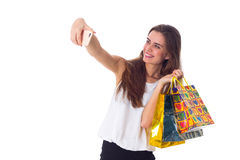 Woman with shopping bags making selfie Stock Photos