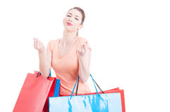 Woman with shopping bags making spending money gesture Royalty Free Stock Image