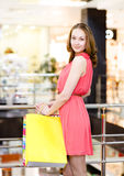 Woman with shopping bags in mall Royalty Free Stock Image