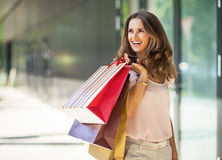 Woman with shopping bags on the mall alley Stock Photo