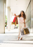 Woman with shopping bags on the mall alley Royalty Free Stock Photography
