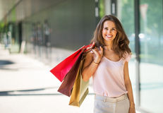 Woman with shopping bags on the mall alley Royalty Free Stock Images