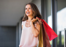 Woman with shopping bags on the mall alley Royalty Free Stock Photo