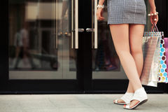 Woman with shopping bags at the mall doorway Stock Image