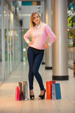 Woman with a shopping bags in the mall Stock Photo