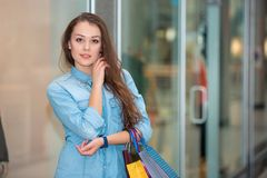 Woman with a shopping bags in the mall Stock Photos