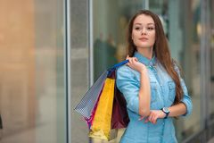Woman with a shopping bags in the mall stock photography