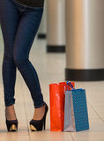 Woman with a shopping bags in the mall Royalty Free Stock Image