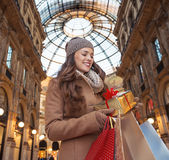 Woman with shopping bags in Milan looking on Christmas gift Royalty Free Stock Photo