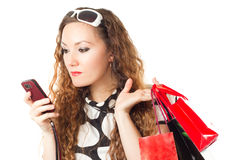 Woman with  shopping bags and mobile phone Stock Image
