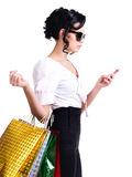 Woman with shopping bags and mobile phone. Stock Photo