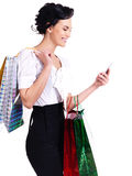 Woman with shopping bags and mobile phone. Royalty Free Stock Image