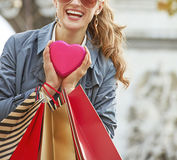 Woman with shopping bags near Arc de Triomphe in Paris, France. Stylish Valentines Day in Paris. Closeup on happy trendy woman in sunglasses with shopping bags Royalty Free Stock Image