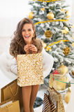 Woman with shopping bags near christmas tree Royalty Free Stock Image