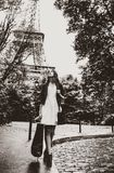 Woman with shopping bags near Eiffel tower royalty free stock images