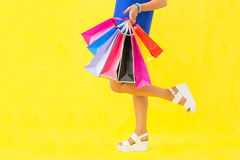 Woman with shopping bags in one hand Stock Photos
