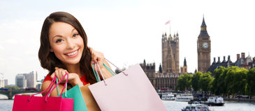 Woman with shopping bags over london city Stock Photography