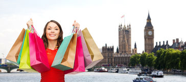 Woman with shopping bags over london city Stock Photos