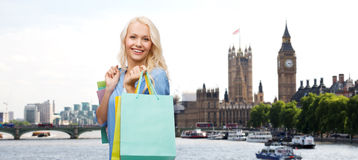 Woman with shopping bags over london city Royalty Free Stock Photos