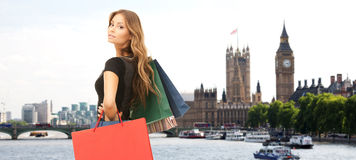 Woman with shopping bags over london city Stock Images