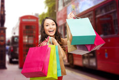 Woman with shopping bags over london city street Royalty Free Stock Photo