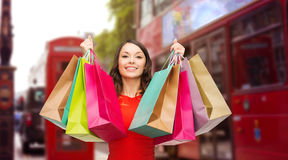 Woman with shopping bags over london city street Royalty Free Stock Images