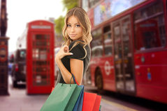 Woman with shopping bags over london city street Stock Photos