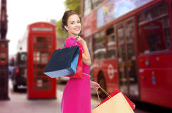Woman with shopping bags over london city street Stock Image