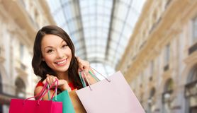 Woman with shopping bags over mall background royalty free stock photography