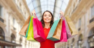 Woman with shopping bags over mall background stock image
