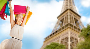 Woman with shopping bags over paris eiffel tower Royalty Free Stock Photo