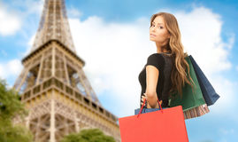 Woman with shopping bags over paris eiffel tower Royalty Free Stock Image
