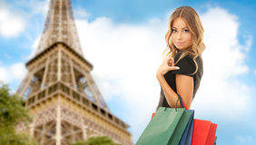 Woman with shopping bags over paris eiffel tower Royalty Free Stock Photos