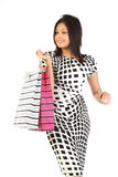 Woman with shopping bags over white Stock Photography