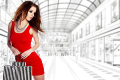 Woman with shopping bags over white Royalty Free Stock Photos