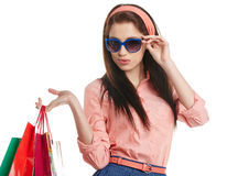 Woman with shopping bags over white Stock Images