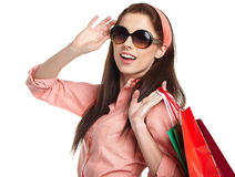 Woman with shopping bags over white Stock Photos