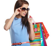 Woman with shopping bags over white Royalty Free Stock Photography