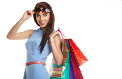 Woman with shopping bags over white Royalty Free Stock Images