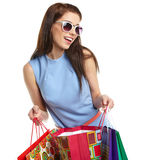 Woman with shopping bags over white Stock Image